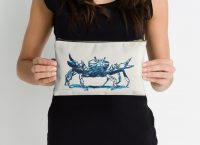 Crab design decorating a Redbubble studio pouch